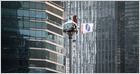Profile of Kim Yong-hee, who has staged a 315+ day sit-in atop an 82 foot traffic camera tower outside Samsung's Seoul HQ to protest its anti-union efforts (Choe Sang-Hun/New York Times)